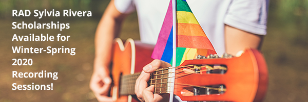 Guitar player displaying LGBTQIA flag